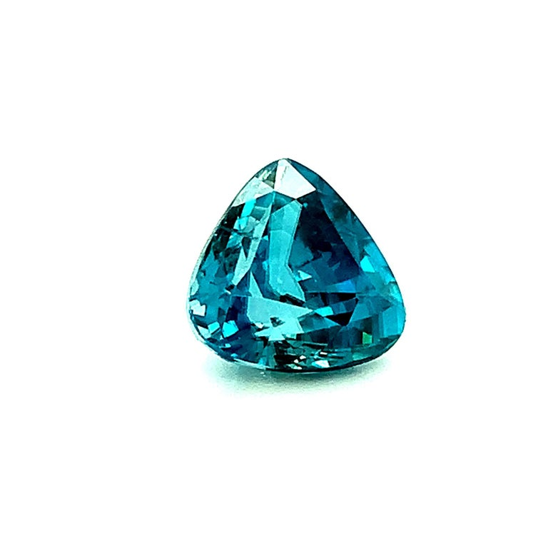 This trillion cut blue zircon would look beautiful set in a custom designed pendant or necklace enhancer. With a vivid,