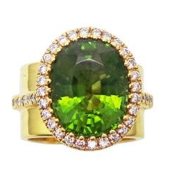 8.49 Carat Burmese Peridot and Diamond Halo Gold Ring