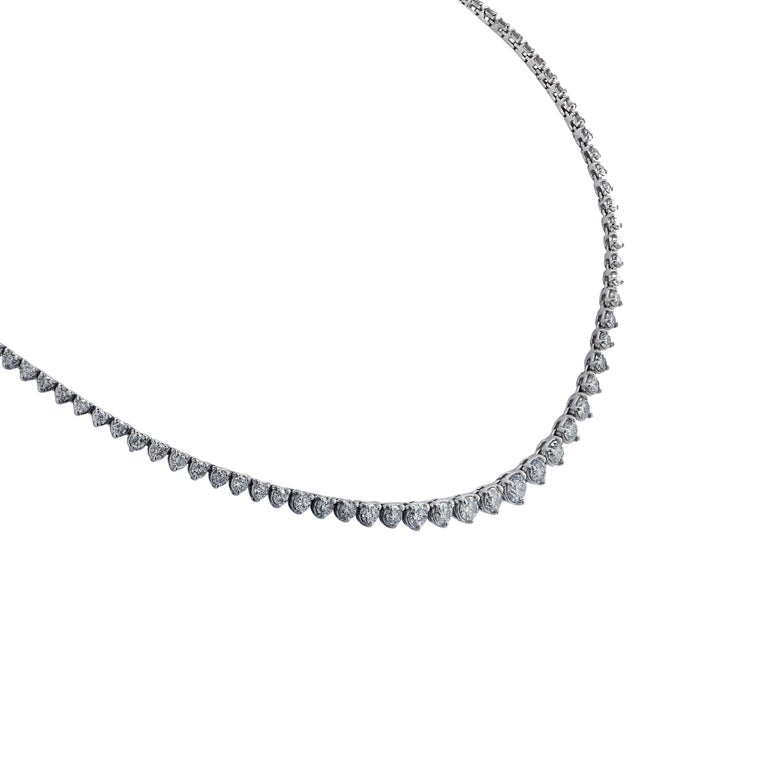Exquisite graduated riviere diamond necklace crafted in white gold, showcasing 114 round brilliant cut diamonds weighing approximately 8.50 carats total, G color, SI2-3 clarity. The diamonds are set in a seamless sea of eternity, creating a