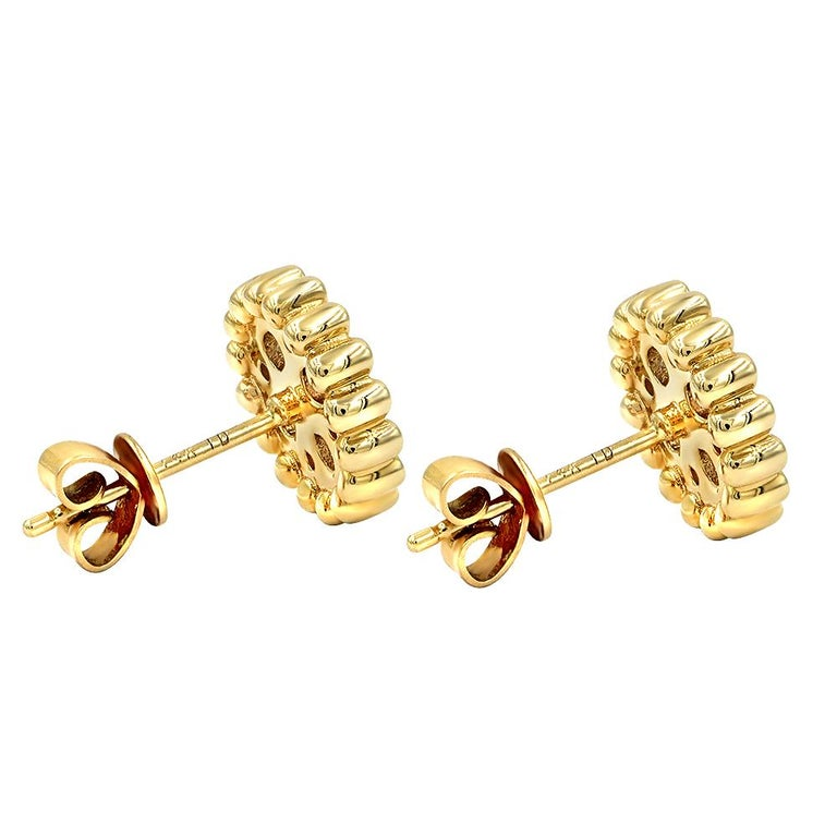 .85ct round brilliant cut diamond stud earrings. Handcrafted in 14k yellow gold. Diamonds are handset in pave setting. Earrings have secure pushback.