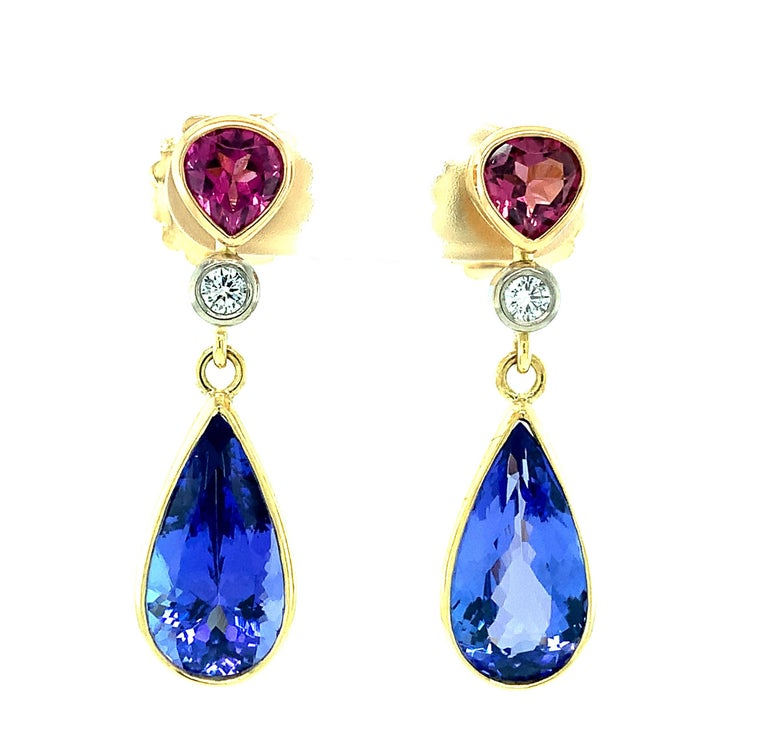 Color, shape and proportion define these beautiful, one-of-a-kind earrings. All stones are bezel set in 18k gold, made by our Master Jewelers in Los Angeles. A large pair of beautifully matched, gem quality tanzanites are featured in these earrings.