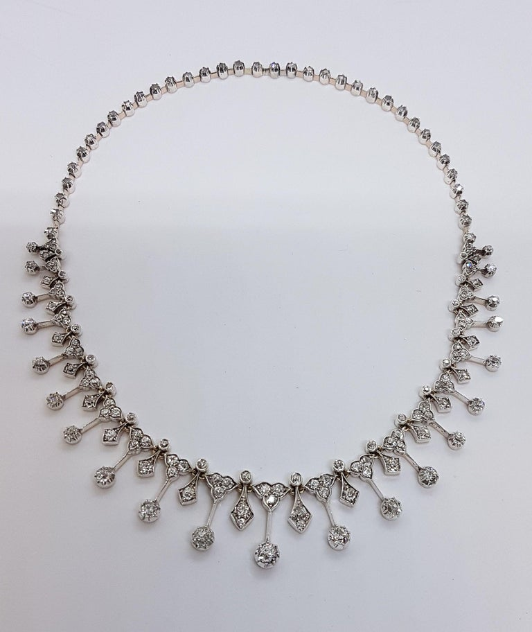 Magnificant tiara made of white gold with different size old european cut diamonds, totaling 8.56 carats. Brook & Son Edinburgh, Jeweller to the Queen The tiara can be taken apart and with an extension assembled to an elegant collier. Very good