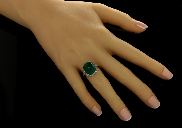 8.59ct sugar loaf cabochon Colombian emerald with AGL certificate Pair of F+ VS+ grade bullet cut diamonds with a combined weight of 1.37cts. Platinum with maker's signature UK finger size L, can be adjusted to your own finger size 8.2 grams  A