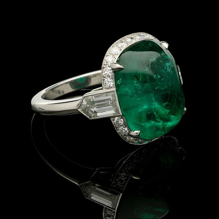 Contemporary 8.59 Carat Sugar Loaf Cabochon Colombian Emerald Ring with Diamond Halo For Sale