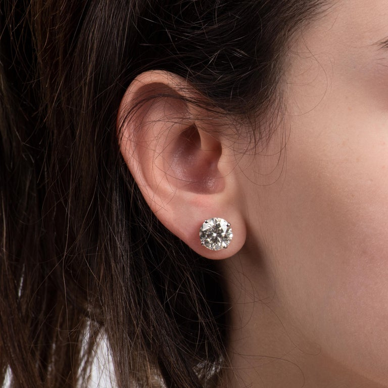 This stunning pair of classic studs are the perfect upgrade to any jewelry collection. With 8.66ct total weight in round brilliant cut diamonds, H/I color, I2 clarity, and set in 14kt white gold, they are simply luxurious. The white and clear