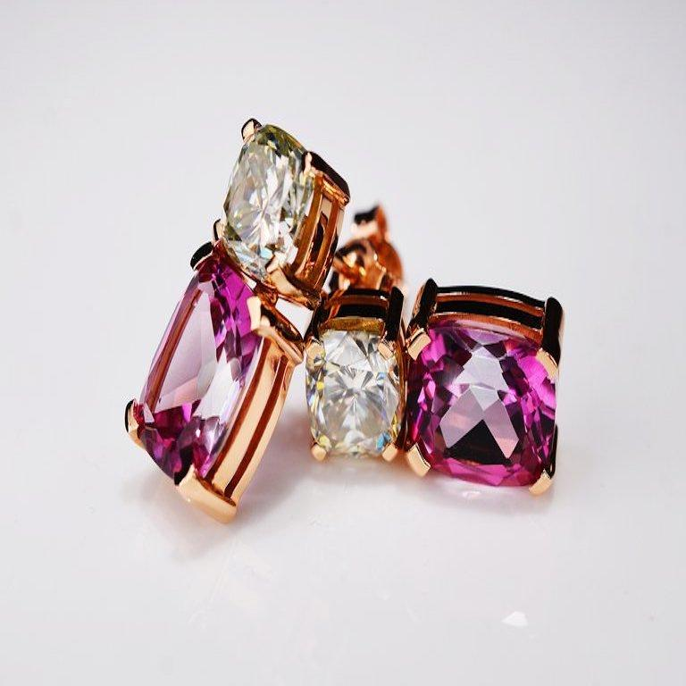 Contemporary style 18 karat rosé golden earrings, each featuring a 1.35 carat off white cushion cut moissanite and a 3.00 carat vivid pink modified cushion cut topaz. Total set features 2.70 carat moissanite and 6.00 carat topaz. One of a kind