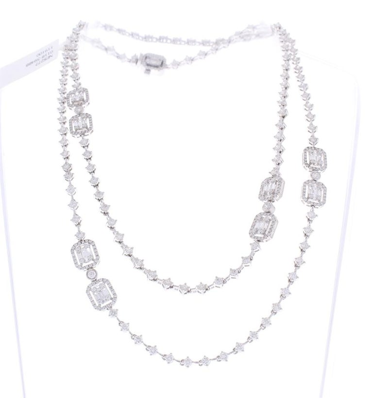 Two layering strands of diamond decadence make this stunning art deco necklace. Round brilliant cut diamonds adorn both strands in round shaped links totaling 7.50 carats. Shimmering baguette cut diamonds are jauntily set in intervals on both