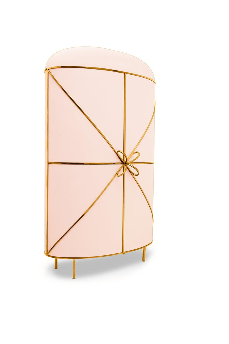88 Secrets Pink Bar Cabinet with Gold Trims by Nika Zupanc is a chic pink bar cabinet in sensuous, feminine lines with luxurious gold metal trims. A statement piece in any interior space!  Nika Zupanc, a strikingly renowned Slovenian designer, never