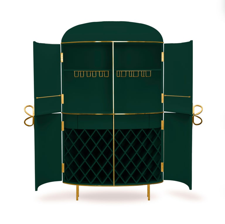 88 Secrets Green Bar Cabinet with Gold Trims by Nika Zupanc is a rich, deep green bar cabinet in sensuous, feminine lines with luxurious metal trims in gold. A statement piece in any interior space!   Nika Zupanc, a strikingly renowned Slovenian