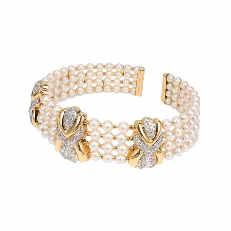 1980's pearl and diamond multi strand choker necklace.  18k yellow 4 wire rows of round pearls with yellow gold separators. Elegantly fits a 15 to 16 inch neck. Still wearable at 17 inches. Set with 8.90cts of full cut diamonds with excellent color