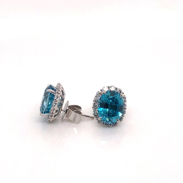 8.90 Carat Blue Oval Zircon Stud Earrings with 1.30 Carat Round Diamond Halos In New Condition For Sale In Houston, TX