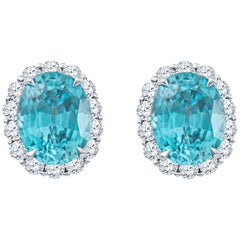 8.90 Carat Blue Oval Zircon Stud Earrings with 1.30 Carat Round Diamond Halos