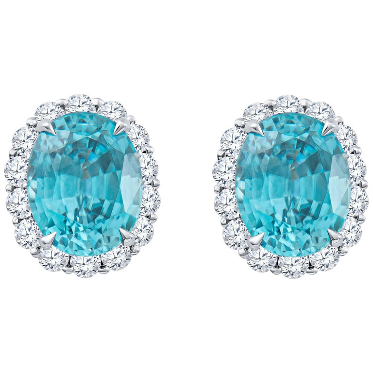 8.90 Carat Blue Oval Zircon Stud Earrings with 1.30 Carat Round Diamond Halos For Sale