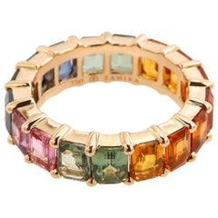 8.97 Carat Emerald Cut Rainbow Sapphire Eternity Band in 18 Karat Pink Gold