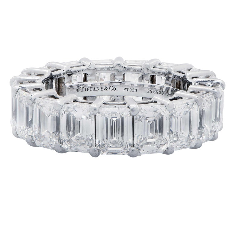 Tiffany and Company Platinum Diamond Eternity Band Ring features 17 Perfectly Matched Emerald Cut Diamonds with a Total Weight of 8.98 Carats. Diamonds are G/H Color VVS2-VS1 clarity.  Ring Size 6. Tiffany and Company Estimated Replacement Value: