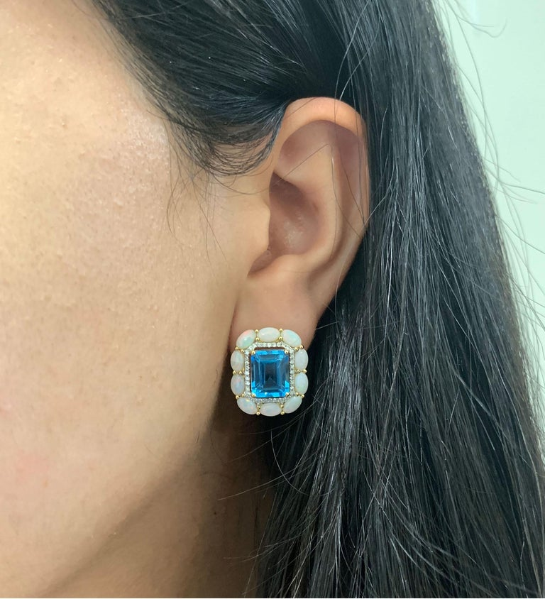 Contemporary 8.99 Carat Blue Topaz, Opal, and Diamond Stud Earrings For Sale