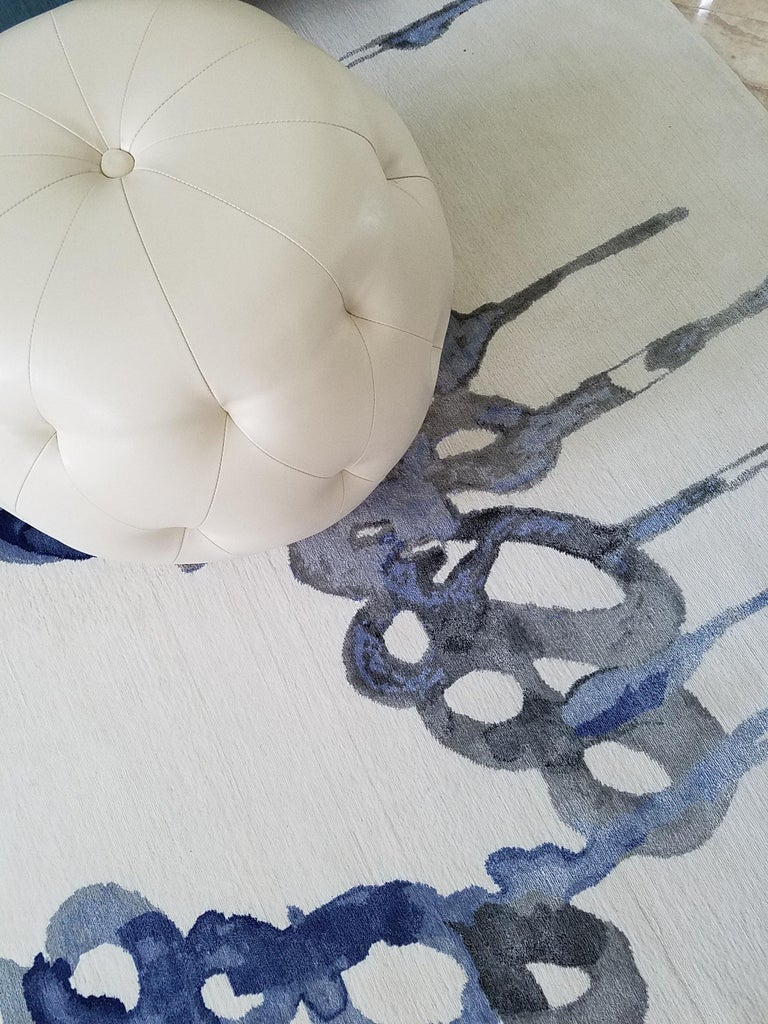 Playing with ambient blues and water lead the designer to an entirely new heights of artistic expression. A painting turned into a stunning piece resembling liquid art, blue mood rug evokes whimsy and wonder. Unmistakably alluring texture thanks to