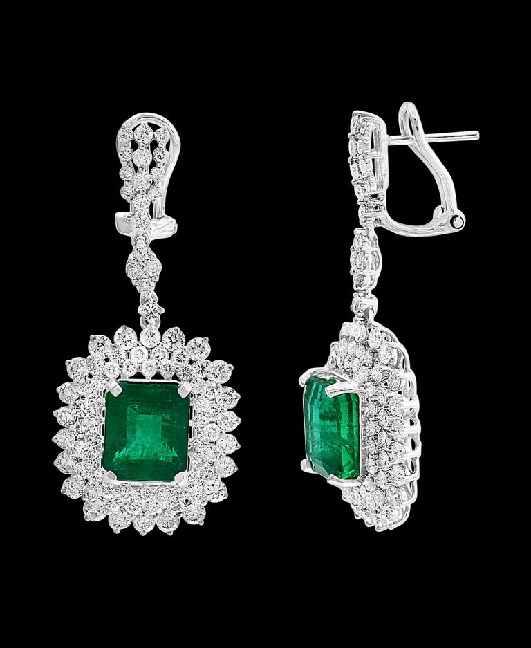 9 Carat Colombian Emerald Cut Emerald Diamond  Hanging Earrings 18 K White Gold This exquisite pair of earrings are beautifully crafted with 18 karat White gold  weighing   9 grams Two fine Natural  Colombian  Emerald  Cut Emeralds weighing