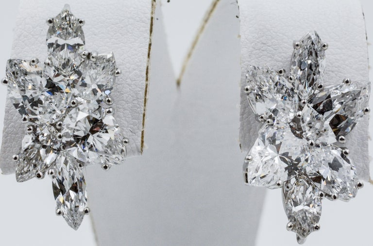 The cluster earrings feature eight pear shape diamonds weighing a total of 7.46 carats and four marquise diamonds, weighing 2.12 carats with D-E color and VS clarity. These earrings have medium friction backs and has loop on bottom to add a