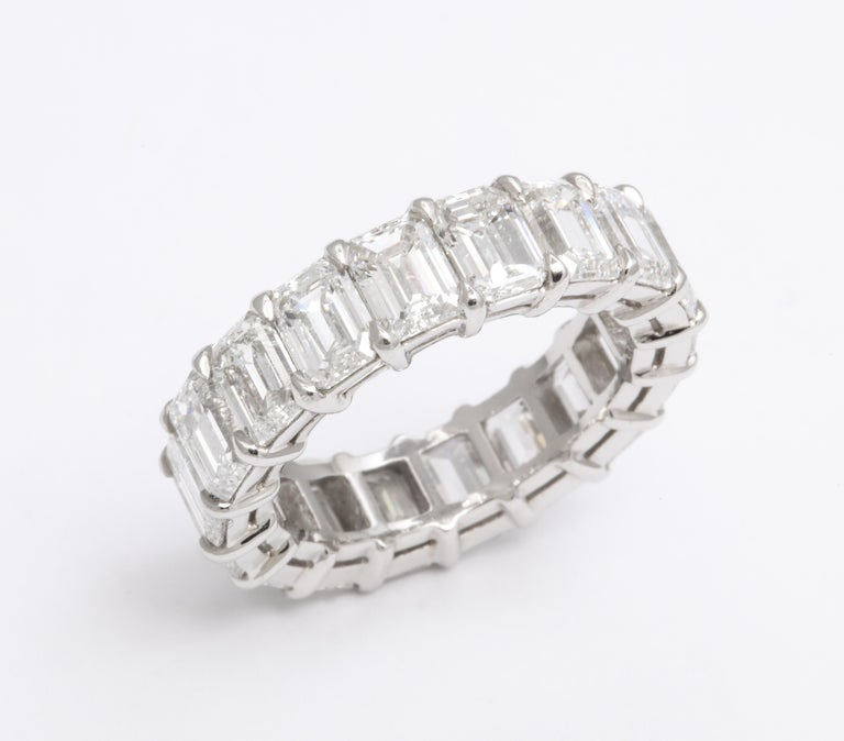 An impressive and wearable diamond band.  9.01 carats of white Emerald cut diamonds set in a custom platinum mounting.   6 mm wide  Size 6.5, the size can be adjusted slightly.