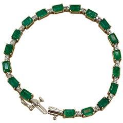 9 Carat Emerald Cut Emerald and Diamond Tennis Bracelet 14 Karat Yellow Gold