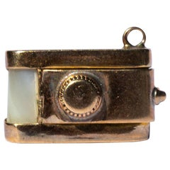 9 Carat Gold and Mother Pearl Opening Camera Pendant