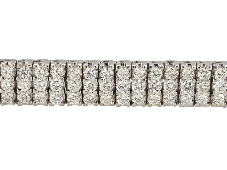 14 Karat White Gold Articulated Three Row Bracelet Featuring 225 Prong Set Round Brilliant Cut Diamonds Totaling Approximately 9 Carats Of VS Clarity & J Color. Hidden Safety Under Clasp For Extra Security.