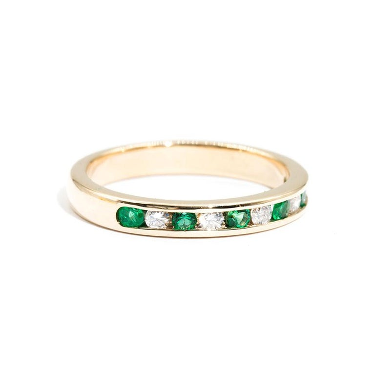 Forged in 9 carat yellow gold is this darling vintage ring featuring a charming row of sparkling round white diamonds and gorgeous round green emeralds. We have named this vintage splendour The Roberta Ring. The Roberta Ring is perfect on her own,