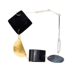 9 Karat Gold, Patinated Steel, Gold Leaf, Hammered Silver Shapes Necklace