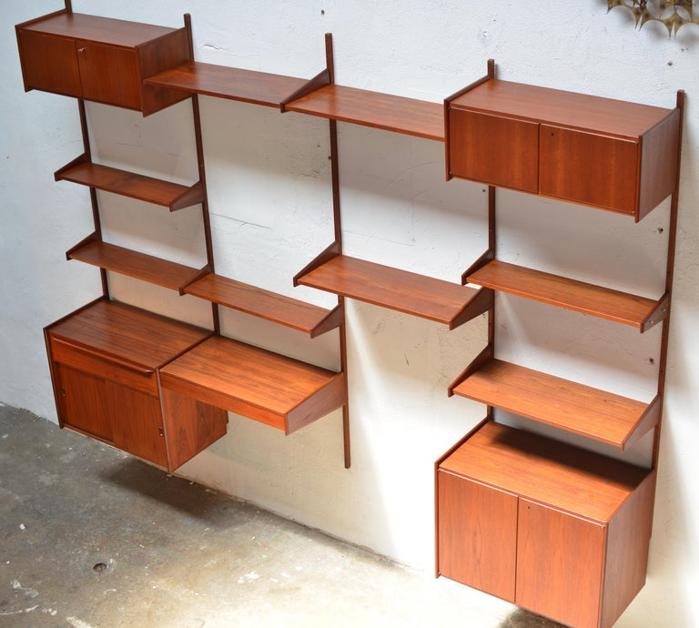 We have over 90 pieces of this is a great Scandinavian Modern wall unit made from beautifully selected teak veneer over solid wood. Current inventory includes over 10 solid teak wall panels (see last photo), 60 shelves, 4 cabinets, 1 doublewide