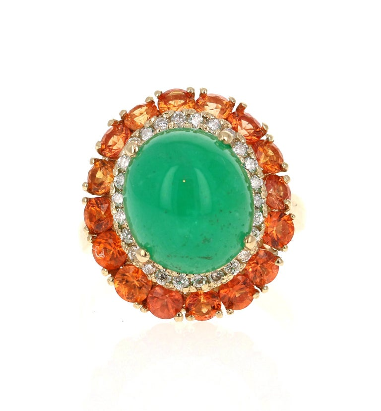 9.04 Carat Emerald Diamond  and Orange Sapphire Cocktail Ring!  The most unique ring of all! A beautiful Cabochon Emerald sits in the center of the ring and is surrounded by a cluster of Orange Sapphires and Diamonds.    The carat weight of the