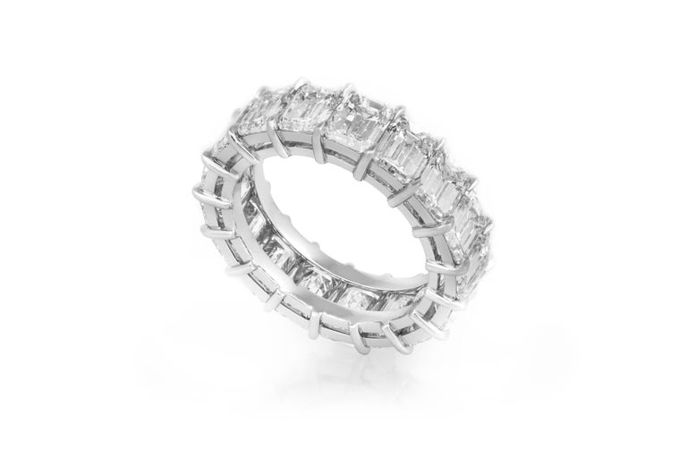 Estate Platinum Eternity Ring features 17 emerald cut diamonds, weighing a total of 9.06 carats. Ring Size 5.5. May be sized upon request.Additional charges may apply.Circa 1990's.