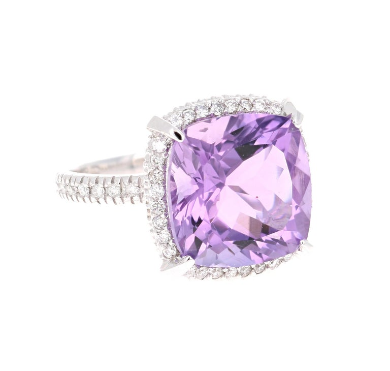 This beautiful ring has a 8.64 Carat Cushion Cut Amethyst and is surrounded by 50 Round Cut Diamonds that weigh 0.43 carats  (Clarity: SI, Color: F). The total weight of the ring is 9.07 carats.   The ring is designed in 14K White Gold and weighs