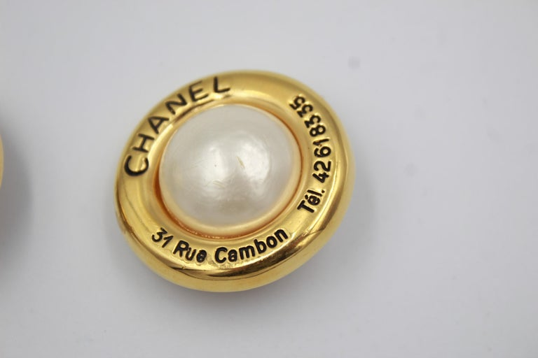 Vintage 90's Chanel earirngs Gold plated metal with inscription of the adresse and telephone number of the Chanel boutique  Size 3.5 cm Clip system