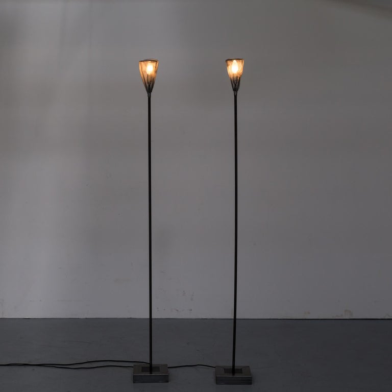 One set of two original 1990s edition metal floor lamps for Baxter Italy. Good and working condition consistent with age and use.