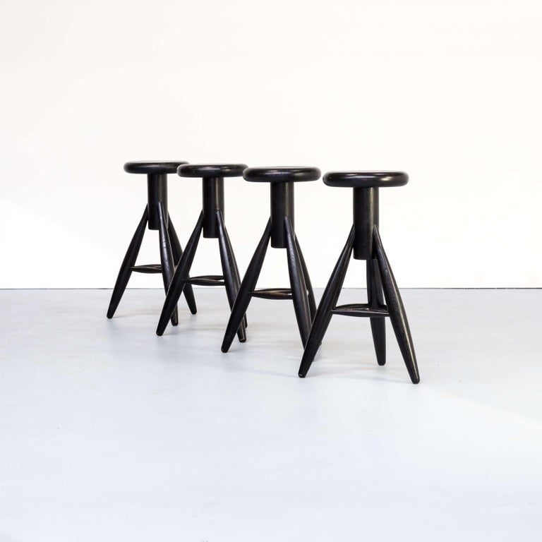 1990s Eero Aarnio 'EA001' black stool for Artek set/4. This set of four amazingly shaped black wooden stools is called EA001. He designed the EA001 primarily for his home kitchen bar. Full wooden quality, timeless object. Good condition consistent