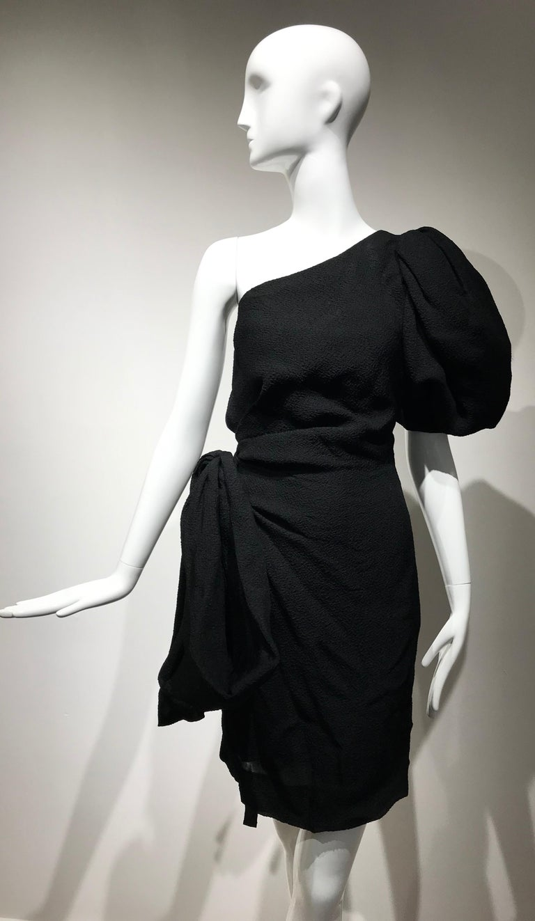 Beautiful Vintage Givenchy designed by Hubert de Givenchy black silk matellasse one shoulder dress with puffy sleeves and bow on the side.  Size:  small Bust: 36 inches/ Waist: 28 inches/  hip: 36 inches