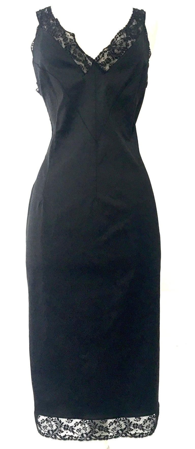 90'S Iconic Italian Dolce & Gabbana (D&G) Little Black Slip Style Dress. This forgiving form fitted stretch black