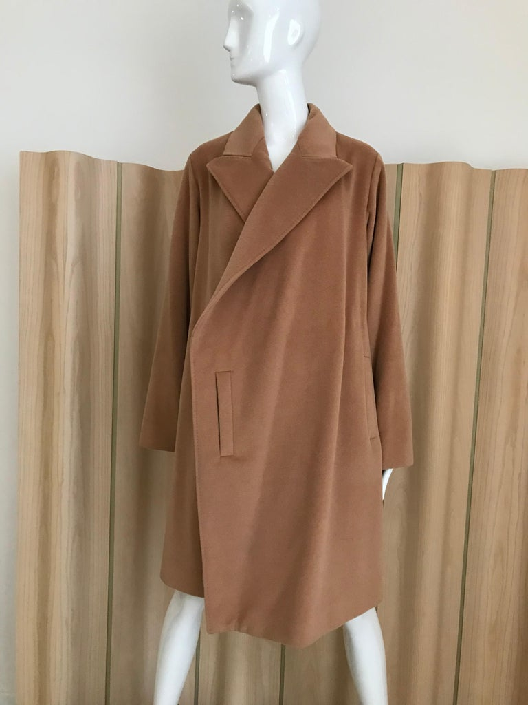 Chic and soft vintage 90s Jean Paul Gaultier wrap around cashmere coat in camel color lined in silk. coat comes with belt.  Size : Medium / coat marked size 40 . Fit US size 6/8