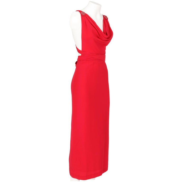 Sophisticated Lancetti red silk long dress with a soft drapery on the neckline, pleated details and decorative beaded medallions at the base of the straps, open back and long crossed band straps on the back. Six silk-covered button fastening on the
