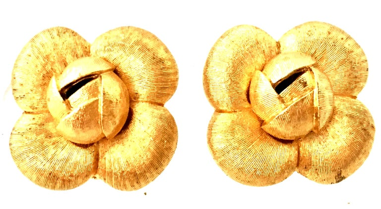 1990'S Organic Modern Brushed Gold Plate Abstract Flower Earrings By, St. John. Features a dimensional and abstract flower form finished in brushed gold. Each clip style earring is signed on the underside, St. John.