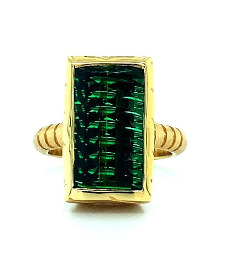 This fine-quality, bright green tourmaline is a combination