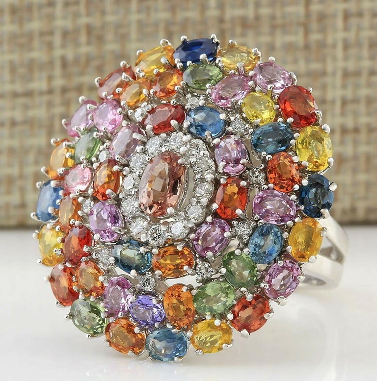 9.19 Carat Sapphire Diamond Ring 14 Karat White Gold .  This show off mix of color Sapphire stones Blue Yellow  Orange  Green Pink  and 21 White Diamonds.   If you are looking for anything specific do let us know as you can have a custom one made.
