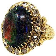 9.21 Carat Oval Cabochon Black Opal and Diamond Halo Cocktail Ring 14 Karat Gold