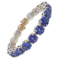 925 and 14 Karat Gold Blue 42.91 Carat Tanzanite Tennis Line Bracelet