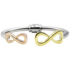 .925 Sterling Silver and 14 Karat Gold Vermeil Infinity Mixed Hinge Bracelet
