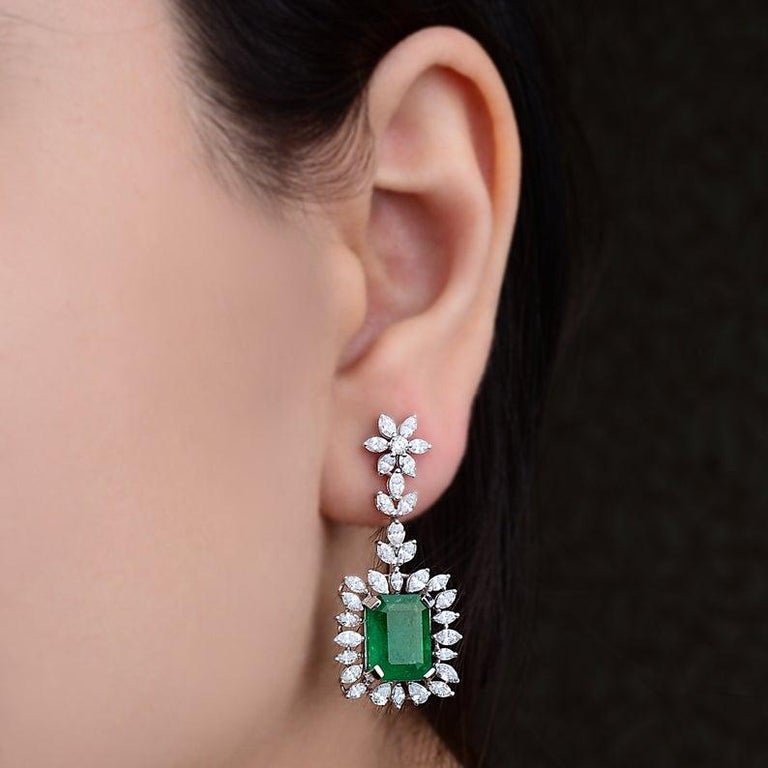 These exquisite earrings are handcrafted in 18-karat gold. It is set in 9.26 carats emerald and 3.60 carats of sparkling diamonds.   FOLLOW MEGHNA JEWELS storefront to view the latest collection & exclusive pieces. Meghna Jewels is proudly rated as