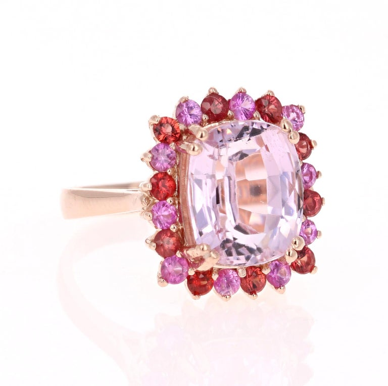 Candy Crush on your Finger!!   This beautiful ring has a huge Emerald-Cushion Cut 7.96 Carat Kunzite that is set in the center of the ring and is surrounded by 20 Round Cut Pink and Deep Orange-Red Sapphires that weigh 1.34 Carats.  The total carat