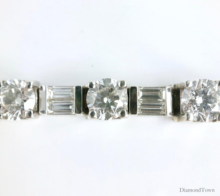 This stunning tennis bracelet features 17 round and 17 baguette diamonds in an alternating pattern, total weight 9.51 carats. The bracelet closes securely by pressure pin and additional clip lock. A suitable bridal accompaniment, or for the event of