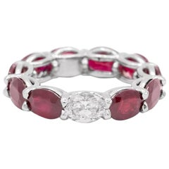 9.51 Carat Ruby and Oval Diamond East West Eternity Band Ring